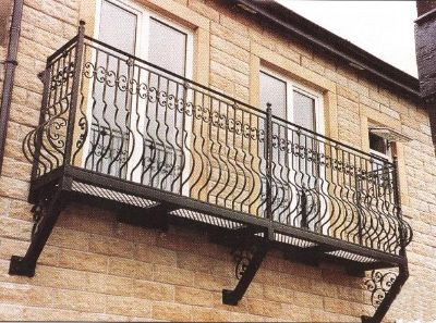 An example of a wrought iron balcony attached to the wall.