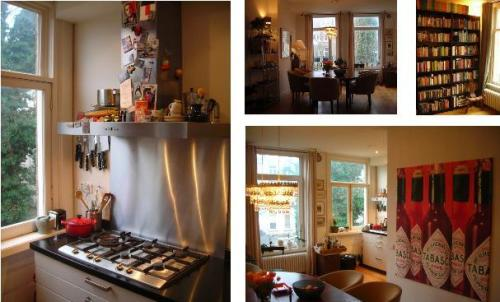 Kitchen, dining room, book shelves and art!