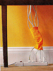 Tube sock cord manager