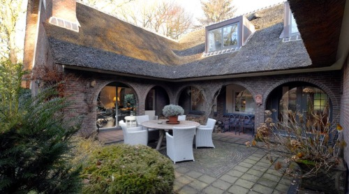 The house is built in a horse shoe shape so features a secluded patio with a veranda.