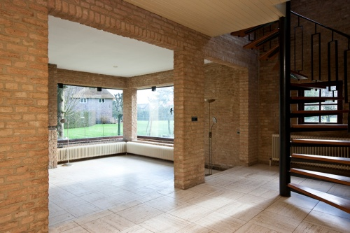 Before: The split-level living room towards the front. Not the view of the monumental farm