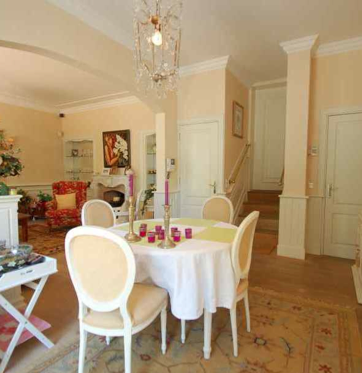 The main floor boasts a wonderful formal living room and eat-in kitchen with doors leading to the garden
